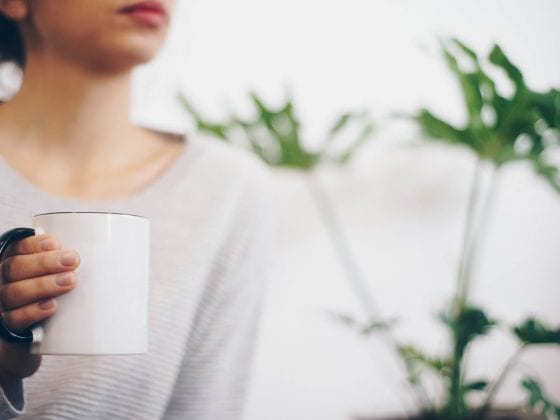 girl hand holding a cup of coffee