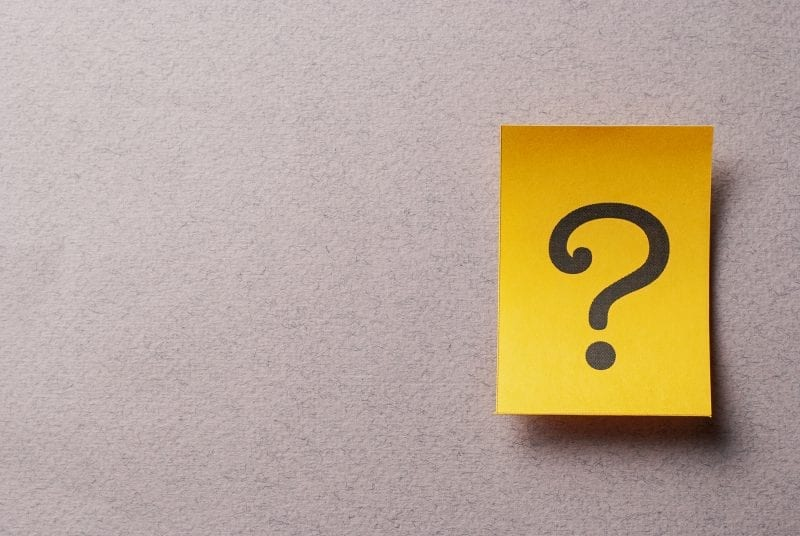 Colorful yellow card with printed question mark - find your why