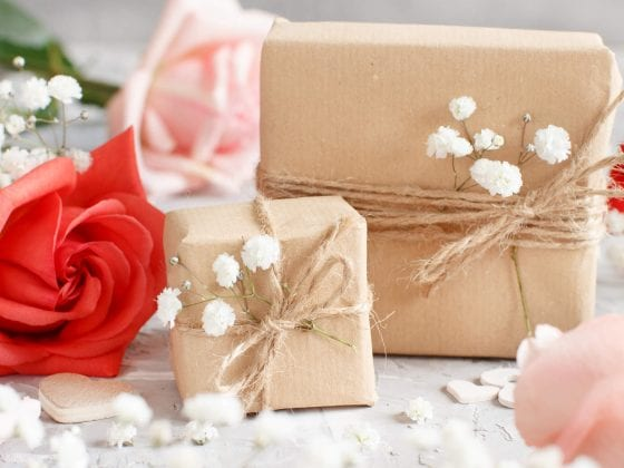 gift boxes and flowers with baby breathe
