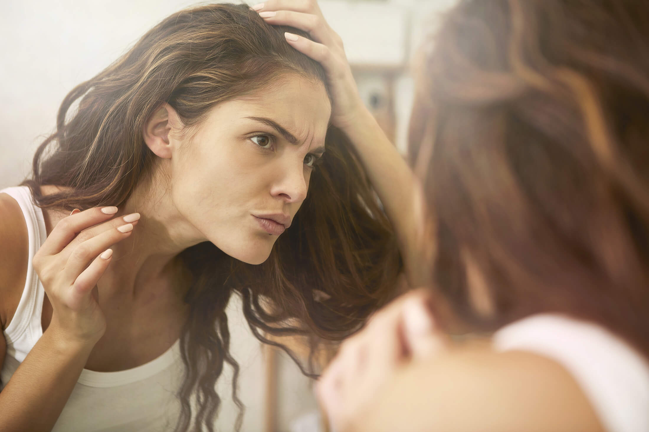 middle age woman looking in the mirror